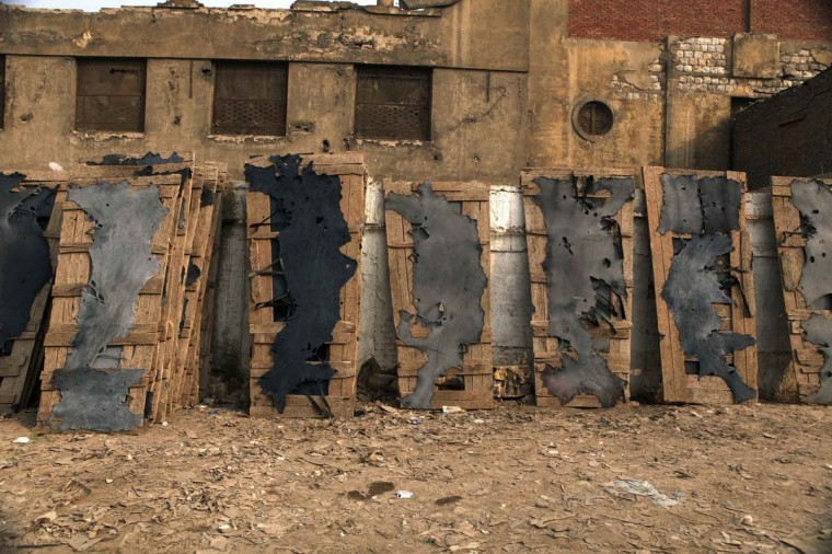 Painted leather are being dried on boards outside a tannery in Old Cairo, December 27, 2012. (Asmaa Waguih/Reuters)