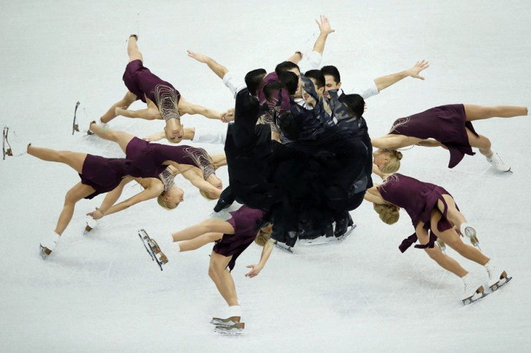Tatiana Volosozhar and Maxim Trankov of Russia perform during the pairs' short programme at the ISU Grand Prix of Figure Skating Final in Sochi. Picture taken using multiple exposures. (Pawel Kopczynski/Reuters)