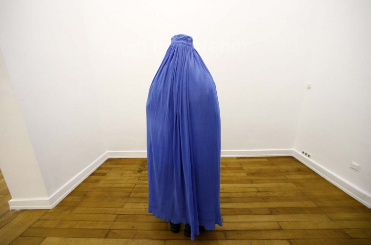 A visitor of the exhibition 'Burquoi' of Naneci Yurdaguel, wearing a burka is pictured at the art gallery Nassauischer Kunstverein Wiesbaden in Wiesbaden, December 2, 2012. The exhibition, named 'Burquoi', a wordplay of the words burka and the French 'pourquoi' 'why' can be visited and experienced by the visitors only in a burka. (Ralph Orlowski/Reuters)