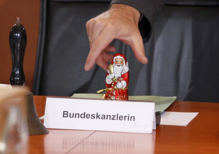 A chocolate Santa Claus, for the occasion of St. Nicholas Day, stands on the table behind the name place card for German Chancellor Angela Merkel before the weekly cabinet meeting in Berlin. (Wolfgang Rattay/Reuters photo)