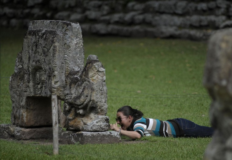 A tourist visits the archaeological site of the Maya civilization of Copan two days before the end of a Mayan calendar cycle. The cycle's end on December 21 has been likened by different groups to the apocalypse, the start of a new, more spiritual age or a good reason to hang out at old Maya temples across Mexico and Central America. (Jorge Cabrera/Reuters)