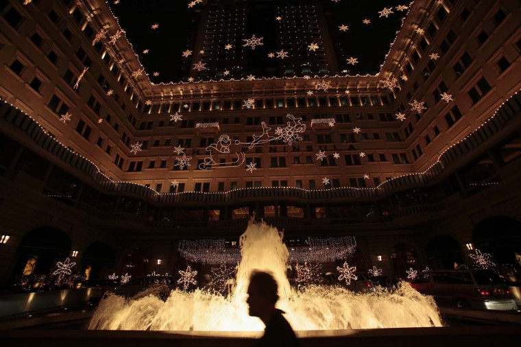 A man walks past the luxurious Peninsula Hotel, opened in 1928 and expanded in 1994, with Christmas decorations in Hong Kong December 5, 2012. Hong Kong is losing its appeal as a convention destination as crowded hotels triple room rates during big events. A shortage of hotels helped push up room rates nearly 12 percent in the first nine months of this year and some industry players expect Hong Kong will overtake Singapore as the world's busiest hotel market in 2013. (Bobby Yip/Reuters)