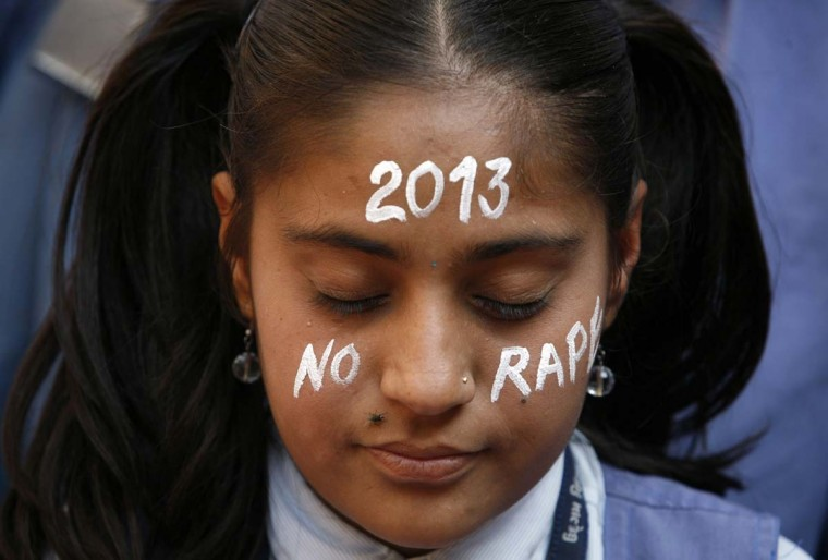 A student prays during a vigil for a gang rape victim, who was assaulted in New Delhi, in Ahmedabad December 31, 2012. One of hundreds of attacks reported in New Delhi each year, the gang rape and murder of a medical student caught Indian authorities and political parties flat-footed, slow to see that the assault on a private bus had come to symbolize an epidemic of crime against women. (Amit Dave/Reuters)