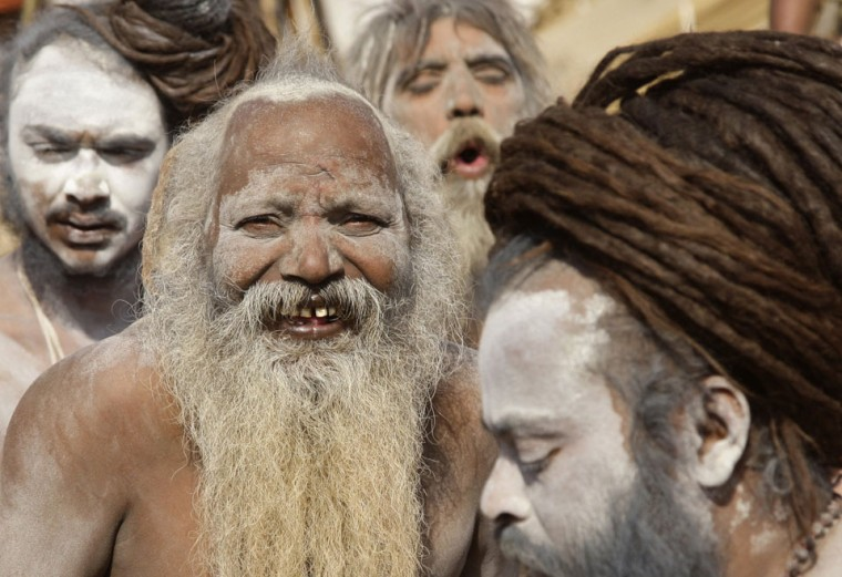Hindu holy men, also known as 'Sadhus,' take part in a procession to attend the 'Kumbh Mela,' or Pitcher Festival, in the northern Indian city of Allahabad. During the festival, hundreds of thousands of Hindus take part in a religious gathering at the banks of the river Ganges. The festival is held every 12 years in different Indian cities. (Jitendra Prakash/Reuters)