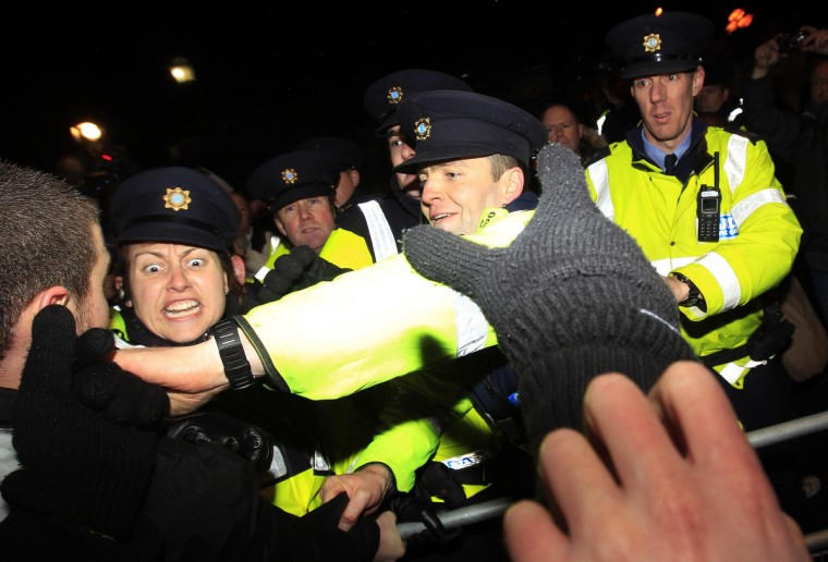 Police and protestors clash outside Government Buildings following the unveiling of the 2013 Irish Budget in Dublin. (Cathal McNaughton/Reuters)