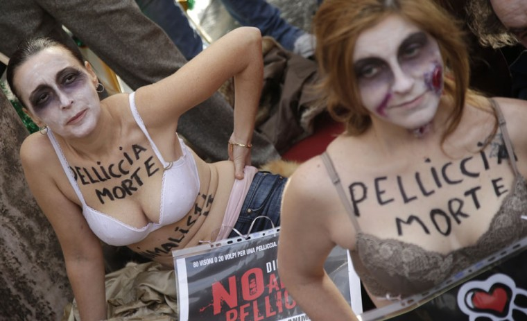 Members of the Italian group Animalisti Italiani has the words 'Fur death' painted on their chests as they perform during a protest in Rome. The protest is part of the campaign 'Fur, no thanks' to protest agains the use of fur in the fashion market. (Max Rossi/Reuters)