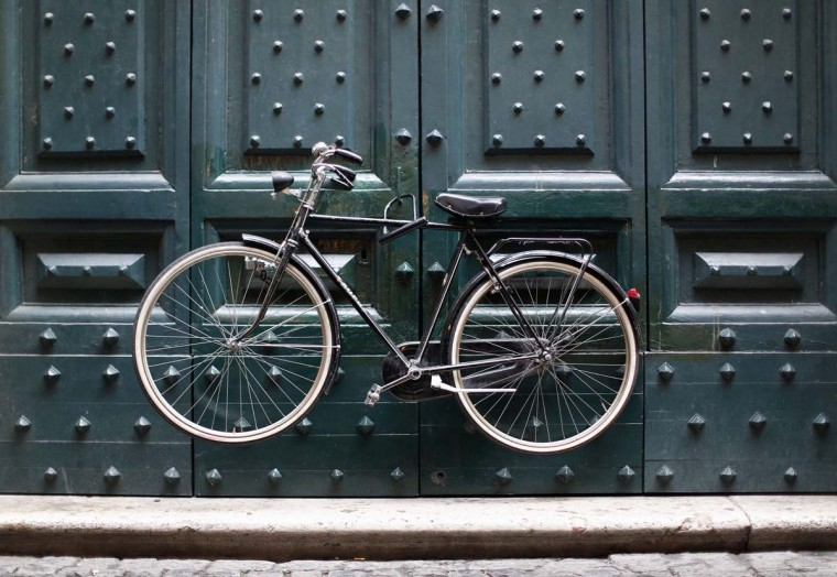 A bike is locked onto a front door in downtown Rome December 10, 2012. (Alessandro Bianchi/Reuters)