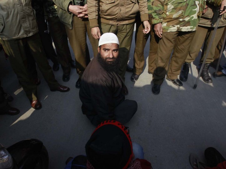 Indian police officers block the way of a member of All Jammu and Kashmir Handicapped Association (AJKHA) before detaining him during a protest to mark World Disability Day in Srinagar December 3, 2012. Police detained nearly a dozen members of AJKHA in Srinagar as they were trying to highlight their problems and demands, AJKHA said. (Fayaz Kabli/Reuters)