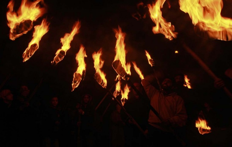 Activists of the Kashmiri separatist party, the Jammu Kashmir Liberation Front (JKLF), shout slogans while holding torches during a procession to mark the International Human Rights Day in Srinagar December 10, 2012. (Fayaz Kabli/Reuters)
