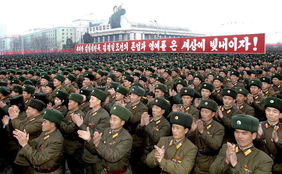 North Koreans attend a rally to celebrate the successful launch of the ...