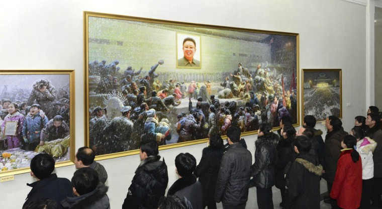 North Koreans look display at an art exhibition titled, 'The great leader Kim Jong-il comrade is with us forever' which was held to honor the memory of North Korea's late leader Kim Jong-il in Pyongyang December 14, 2012 in this picture released by the North's KCNA on Friday. The first anniversary of Kim Jong-il's death is on December 17. (KCNA/Reuters)