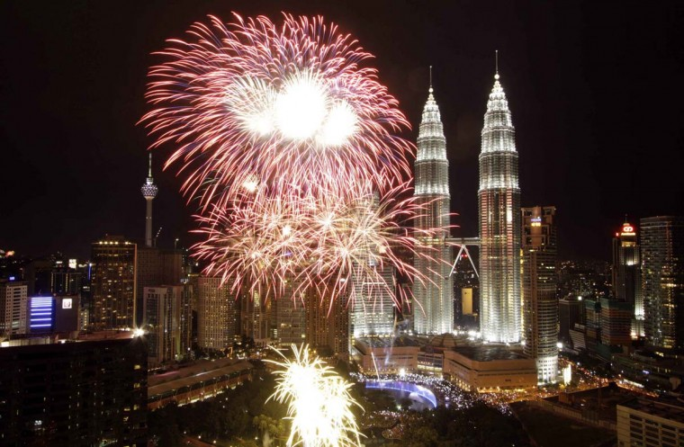 Fireworks explode near the Malaysia's landmark Petronas Twin Towers during New Year celebrations in Kuala Lumpur January 1, 2013. (Syamsul Bahri Muhammad/Reuters)
