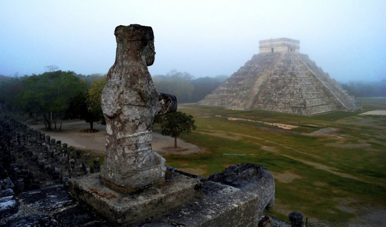 The Maya temple of Kukulkan, the feathered serpent and Mayan snake deity, is seen at the archaeological site of Chichen Itza, in the southern Mexican state of Yucatan. In anticipation for December 21, the end of an era in the 5,125-year Maya calendar, thousands are converging on ancient ruins in southern Mexico and Guatemala. The date has been variously interpreted as the end of days, the start of a new era, or just a solid excuse for a party. (Mauricio Marat/National Institute of Anthropology and History (INAH)/Handout photo for Reuters)