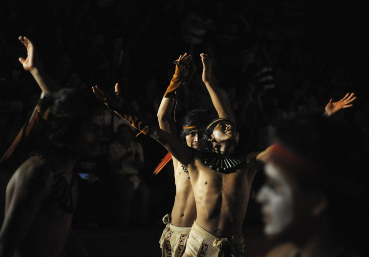 Honduran Ch'orti, of Mayan descent, celebrate a point during a Mayan ball game against Guatemalan Quirigua in Copan, Guatemala. The game was held to celebrate the end of an era in the Maya Long Count Calendar, which takes place on December 21. The date has been likened by different groups to the end of days, the start of a new, more spiritual age, or a good reason to hang out at old Maya temples across Mexico and Central America. (Jorge Cabrera/Reuters)