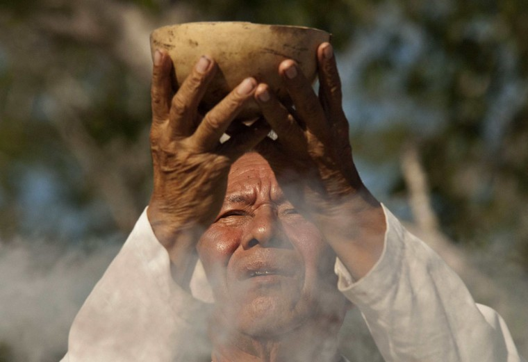 A man takes part in a traditional spiritual ceremony during the Mayan Culture Festival in Merida, Mexico on December 15, 2012. According to organizers, the aim of the festival is to honor Mayan culture and to promote intercultural dialogue, in addition to helping the public better understand the end of the Mayan Long Count calendar, which expires on December 21. Many have predicted the end of the world based on the end of the calendar. (Francisco Martin/Reuters)