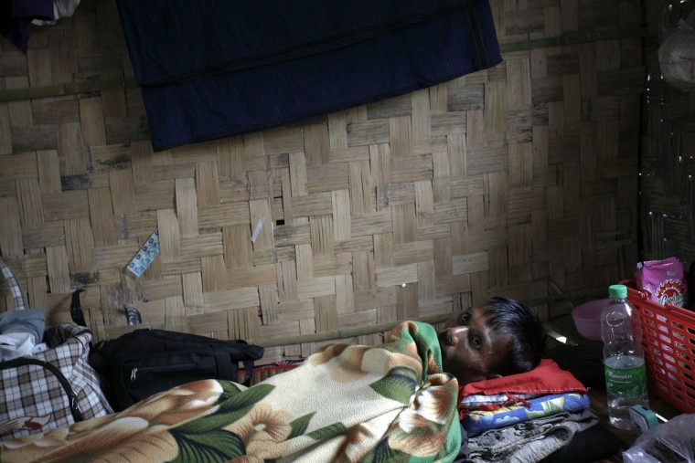 A man infected with HIV rests at an HIV/AIDS hospice, founded by a member of the National League for Democracy (NLD) party, in the suburbs of Yangon, Myanmar, on World AIDS. (Minzayar/Reuters)