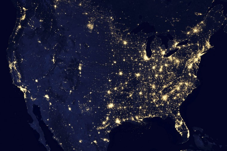 "A NASA handout image of the continental United States at night shows a composite assembled from data acquired by the Suomi NPP satellite in April and October 2012. The image was made possible by the satellite's ""day-night band"" of the Visible Infrared Imaging Radiometer Suite (VIIRS), which detects light in a range of wavelengths from green to near-infrared and uses filtering techniques to observe dim signals such as city lights, gas flares, auroras, wildfires and reflected moonlight. (NASA Earth Observatory/NOAA/Department of Defense)"