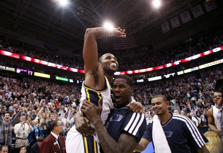 Utah Jazz guard Mo Williams (5) is carried off the court by forward Marvin Williams (2) after hitting the game winning shot at the buzzer ending the second half of their NBA basketball game against the San Antonio Spurs in Salt Lake City, Utah. (Jim Urquhart/Reuters photo)