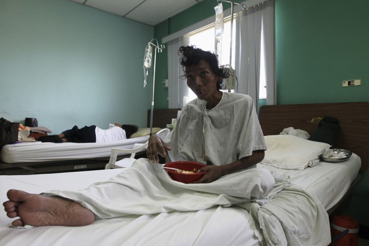 Karla Hernandez, an HIV-positive patient, rests on a bed at the Hospital Manolo Morales in Managua, the capital of Nicaragua. (Oswaldo Rivas/Reuters)