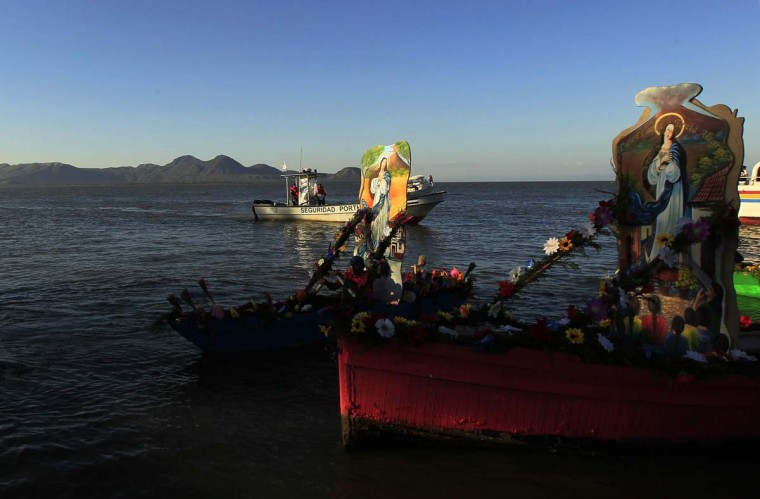 Thousands of Nicaraguan Catholics celebrate the Virgin Mary, a tradition that dates back to some 450 years when her image first came to Nicaragua from Spain, according to believers. Pictured are boats carrying an image of the Virgin Mary (Purisima) on the Xolotlan Lake in Managua City December 8, 2012. (Oswaldo Rivas/Reuters)