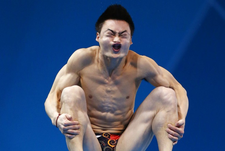 China's Qin Kai performs a dive during the men's 3m springboard preliminary round at the London 2012 Olympic Games at the Aquatics Centre August 6, 2012. (Jorge Silva/Reuters)