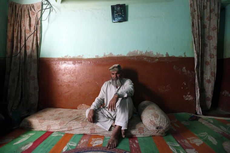 Syed Riaz Shah Shirazi, husband of Fehmida Shah, an anti-polio health worker and mother of six, who was killed by unknown gunmen, sits in a room at his residence on the third day of mourning after her funeral in Karachi December 20, 2012. Picture taken December 20. (Akhtar Soomro/Reuters)