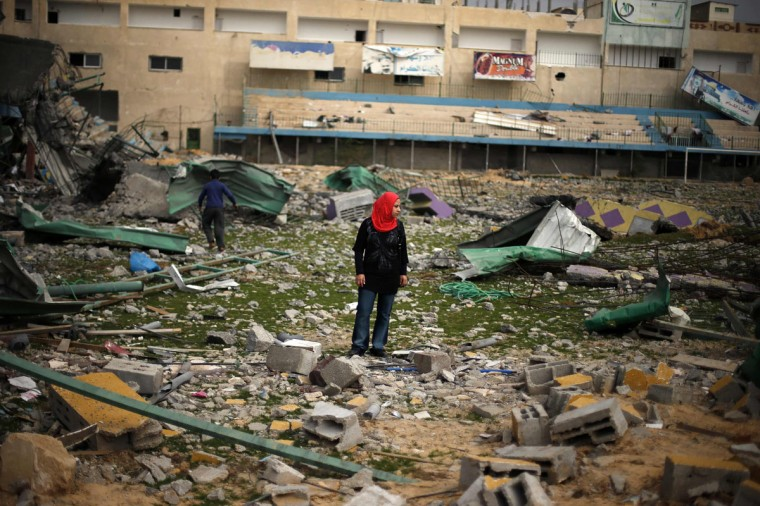 A Palestinian girl looks at a soccer stadium, which witnesses said was destroyed in an Israeli air strike during an eight-day conflict, in Gaza City. Eight days of Israeli air strikes on Gaza and cross-border Palestinian rocket attacks ended in an Egyptian-brokered truce agreement last month, calling on Israel to ease restrictions on the territory. (Suhaib Salem/Reuters)