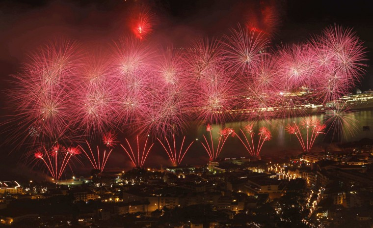 Fireworks explode over the Funchal city bay during New Year celebrations in Madeira island. (Duarte Sa/Reuters)