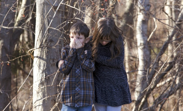 First-grader Henry Terifay and his sister, fourth-grader Kelly Terifay, wait outside Sandy Hook Elementary School after a shooting in Newtown, Connecticut, December 14, 2012. A shooter opened fire at the elementary school. (Michelle McLoughlin/Reuters)
