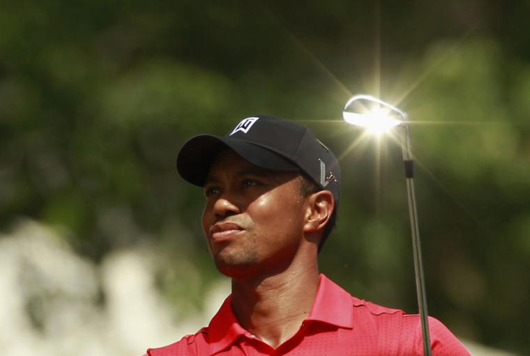 The sun reflects off the club as Tiger Woods hits off on the seventh tee during the final round of the AT&T National golf tournament at Congressional Country Club in Bethesda, Maryland July 1, 2012. (Kevin Lamarque/Reuters)