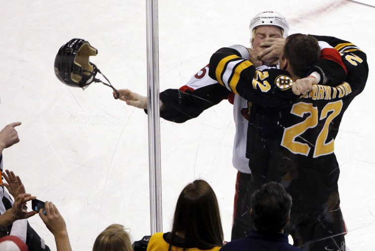 Boston Bruins' Shawn Thornton (R) fights with Ottawa Senators' Chris Neil during the first period of their NHL hockey game at TD Bank Garden in Boston, Massachusetts January 31, 2012. (Jessica Rinaldi/Reuters)