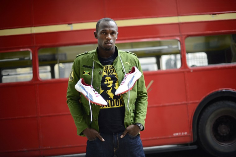 Sprinter Usain Bolt of Jamaica poses with his running spikes and official team uniform for the London 2012 Olympic Opening Ceremony during a photo shoot, arranged by his sponsors PUMA, beside a traditional route master bus outside the British Museum in London June 1, 2012. Bolt will defend the 100m and 200m gold medals he won in Beijing in this summer's Games. (Dylan Martinez/Reuters)