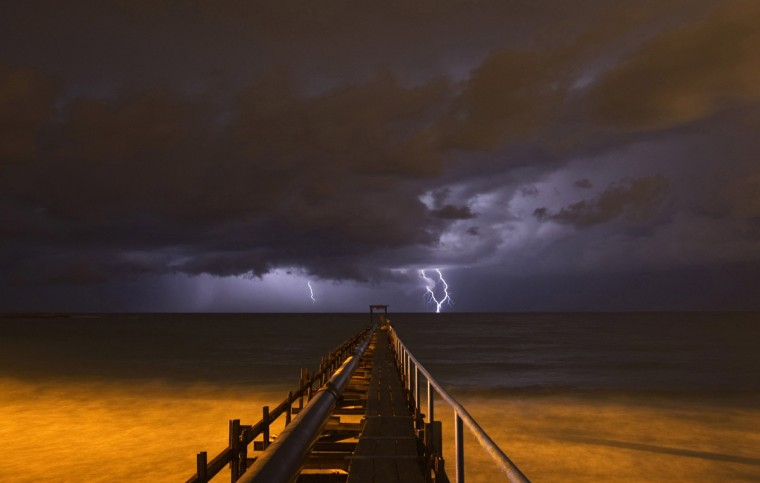 Lightning strikes over a pier during a storm in Atlit, near the northern Israeli city of Haifa October 25, 2012. (Baz Ratner/Reuters)