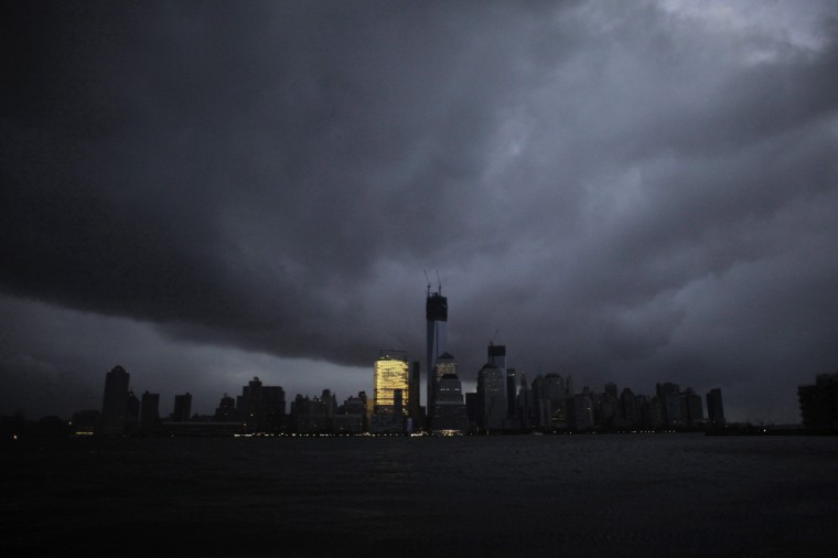The skyline of lower Manhattan, as seen from Exchange Place, is mostly in darkness except for the Goldman Sachs building after a preventive power outage caused by giant storm Sandy, in New York October 30, 2012. Millions of people in the eastern United States awoke on Tuesday to flooded homes, fallen trees and widespread power outages caused by Sandy, which swamped New York City's subway system and submerged streets in Manhattan's financial district. More than two-thirds of the U.S. East Coast's refining capacity was shut down and fuel pipelines idled due to Hurricane Sandy. Early assessments show the region's biggest plants may have escaped without major damage. (Eduardo Munoz/Reuters)
