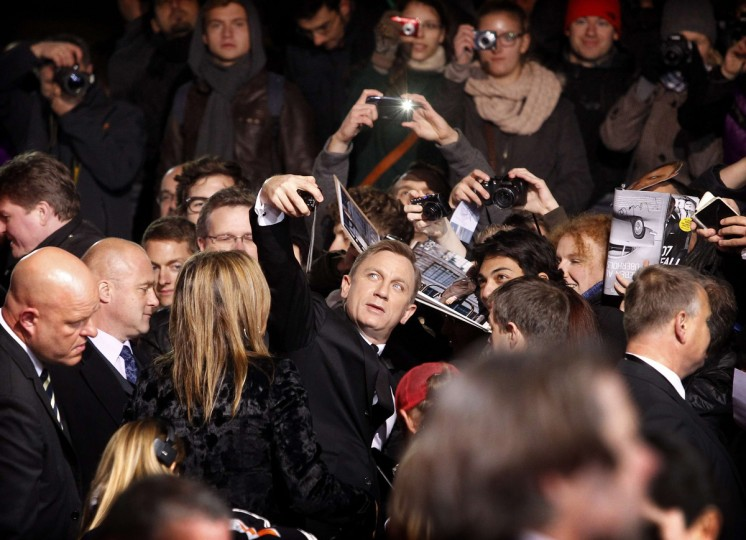 Cast member Daniel Craig (C) takes a photograph of himself with fans as he arrives for the German premiere for the film 'Skyfall' in Berlin October 30, 2012. The new James Bond 007 movie opens in German cinemas on November 1. (Tobias Schwarz/Reuters)