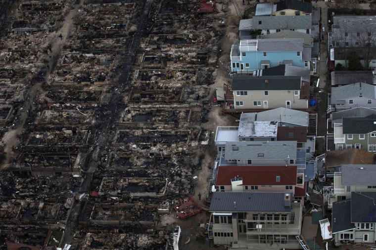 Burned houses are seen next to those which survived in Breezy Point, a neighborhood located in the New York City borough of Queens, after they were devastated by Hurricane Sandy October 31, 2012. Sandy, the massive storm that tore through the U.S. East Coast is being blamed, so far, for the deaths of 64 people, many of whom were killed by falling trees or branches. The storm, at one point extending 1,000 miles in diameter, is making its way north over inland New York, Pennsylvania and into Canada. It knocked out power for millions and crippled transportation systems along the densely populated coastal region. (Adrees Latif/Reuters)