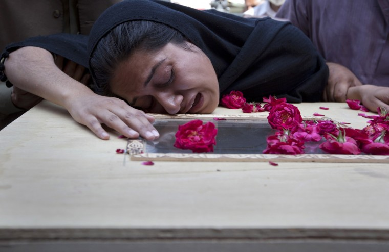 Ayesha Ishaque, sister of Mohammad Saud Ishaque who was killed in a Boeing 737 airliner crash, cries over his casket at the Pakistan Institute of Medical Sciences hospital (PIMS) in Islamabad April 21, 2012. The Pakistani airliner with 127 people on board crashed in bad weather as it came in to land in Islamabad on Friday, scattering wreckage and leaving no sign of survivors. The Boeing 737, operated by local airline Bhoja Air, was flying to the capital from Pakistan's biggest city and business hub Karachi. (Rebecca Conway/Reuters)