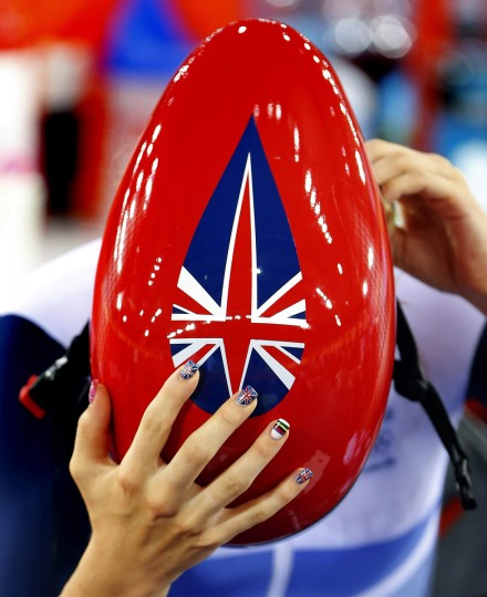 The Union Flag and the rainbow stripes of a world champion cyclist are painted on the fingernails of Britain's Laura Trott ahead of her women's track cycling ominium 3km individual pursuit race at the Velodrome during the London 2012 Olympic Games August 7, 2012. (Cathal McNaughton/Reuters)