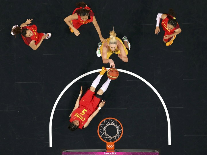 Australia's Lauren Jackson (15) shoots over China's Xiaoyun Song (5) in the women's quarterfinal basketball match at the Basketball Arena in London during the London 2012 Olympic Games August 7, 2012. (Mike Segar/Reuters)