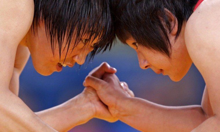 China's Ruixue Jing (L) fights with North Korea's Un Gyong Choe on the Women's 63Kg Greco-Roman wrestling at the ExCel venue during the London 2012 Olympic Games August 8, 2012. (Toru Hanai/Reuters)