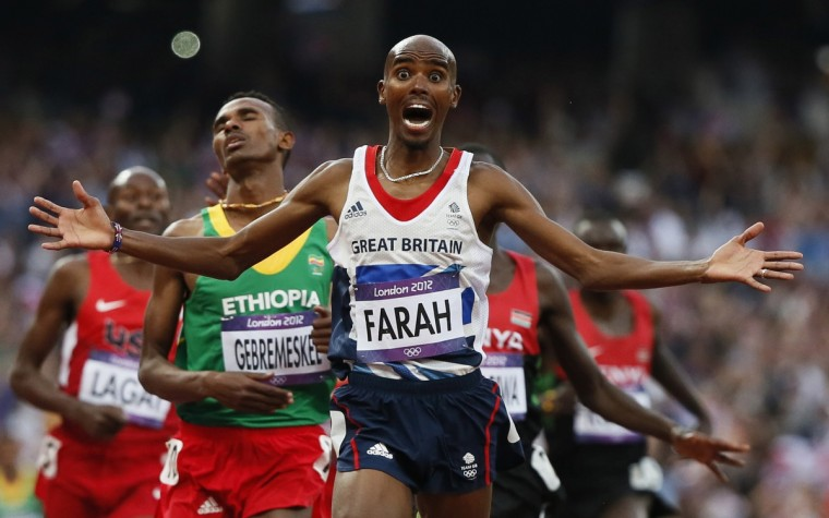 Britain's Mo Farah reacts as he wins the men's 5000m final at the London 2012 Olympic Games at the Olympic Stadium August 11, 2012. (Lucy Nicholson/Reuters)