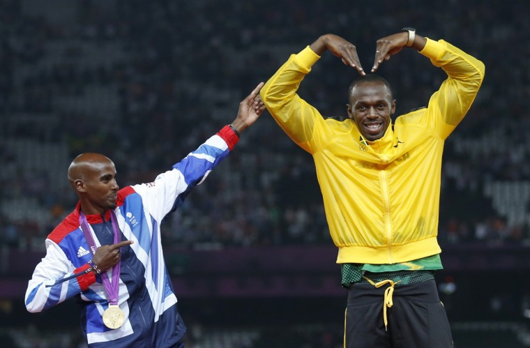 Jamaica's Usain Bolt (R) celebrates with Britain's Mo Farah on the podium after each receiving gold medals, Bolt for men's 4x100m relay and Farah for men's 5000m at the victory ceremony at the London 2012 Olympic Games at the Olympic Stadium August 11, 2012. (Eddie Keogh/Reuters)