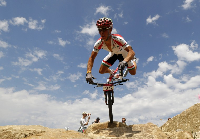 Hungary's Andras Parti reacts as he falls during the men's cross-country mountain bike event at Hadleigh Farm during the London 2012 Olympic Games August 12, 2012. (Stefano Rellandini/Reuters)
