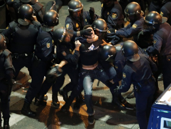 A demonstrator struggles with Spanish National Police riot officers outside the the Spanish parliament in Madrid September 25, 2012. Protesters clashed with police in Spain's capital on Tuesday as the government prepares a new round of unpopular austerity measures for the 2013 budget that will be announced on Thursday. (Sergio Perez/Reuters)