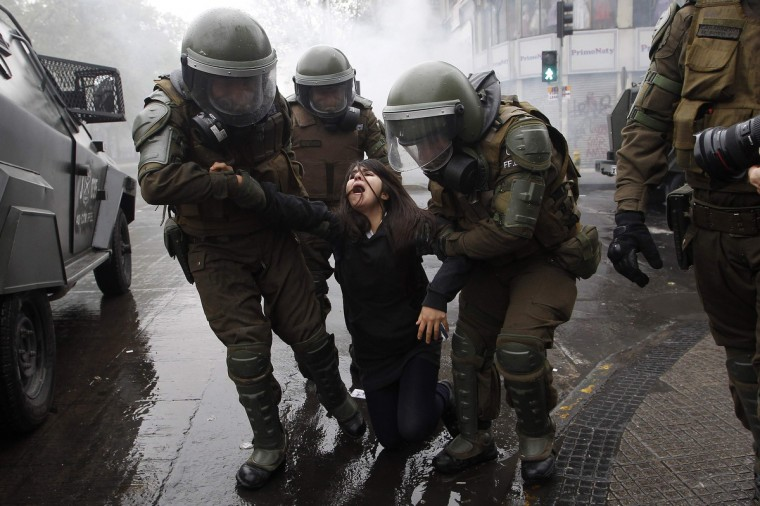 Riot policemen arrest a student protester during a protest against the government to demand changes in the public state education in Santiago, September 27, 2012. Chilean students have been protesting against what they say is profiteering in the state education system. (Ivan Alvarado/Reuters)