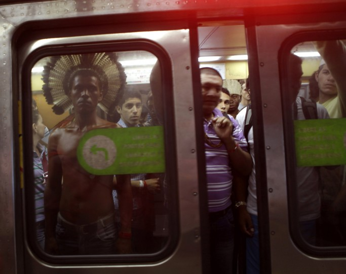An indigenous man stands in a subway train as he makes his way to the People's Summit at Rio+20 for Social and Environmental Justice in Rio de Janeiro June 20, 2012. The People's Summit at Rio+20 for Social and Environmental Justice is a parallel event of the Rio+20 United Nations sustainable development summit. (Ricardo Moraes/Reuters)