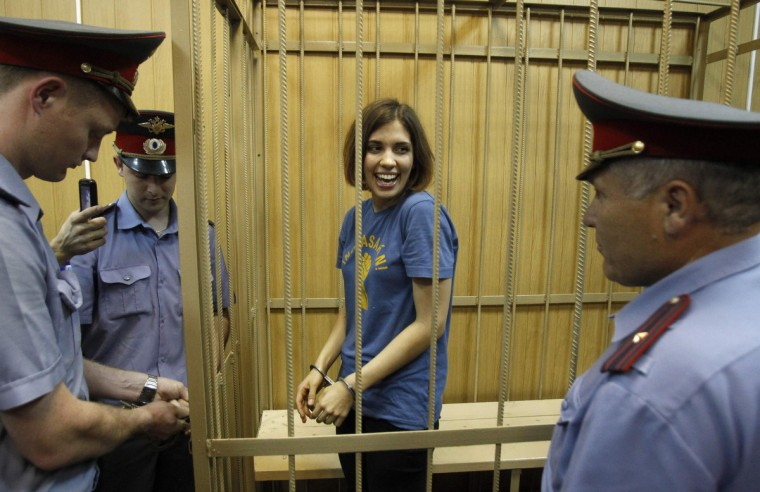"Nadezhda Tolokonnikova, a member of female punk band, ""Pussy Riot"", stands behind bars during a court hearing in Moscow July 4, 2012. Three members of the all-woman punk band ""Pussy Riot"" were detained on February 21, 2012, after they stormed into Moscow's main cathedral to sing a protest song against Vladimir Putin and criticized the Russian Orthodox Church's support for Putin. (Sergei Karpukhin/Reuters)"