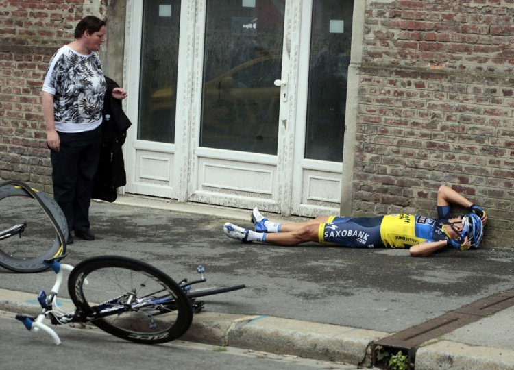 Team Saxo Bank rider Jonathan Cantwell of Australia lies on the ground after a fall during the fifth stage of the 99th Tour de France cycling race between Rouen and Saint-Quentin, July 5, 2012. (Joel Saget/Reuters)