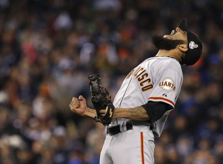 San Francisco Giants relief pitcher Sergio Romo celebrates after the Giants defeated the Detroit Tigers in Game 4 to win the MLB World Series baseball championship in Detroit, Michigan, October 28, 2012. (Mark Blinch/Reuters)