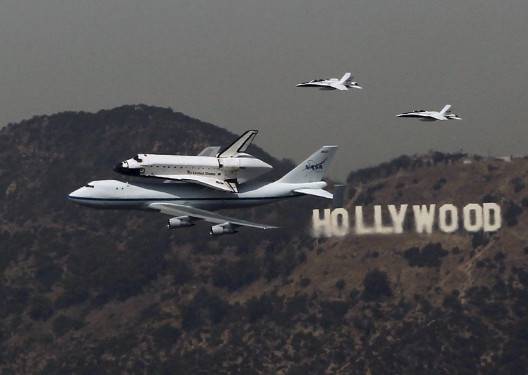 The Space Shuttle Endeavour is escorted by two F18 jets as it passes the Hollywood sign on the back of a 747 on its arrival in Los Angeles September 21, 2012. The Endeavour will be put on display at its new permanent home the California Science Center in October. (Mike Blake/Reuters)